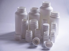 Bottles with tamper evident caps for the packaging of tablets and capsules